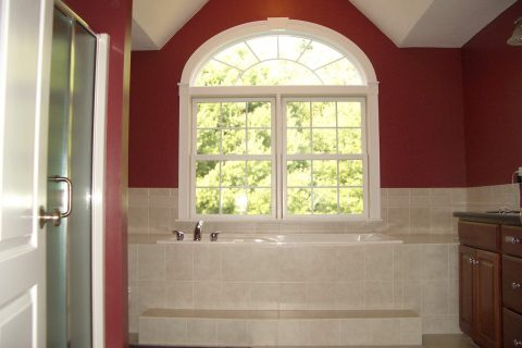 Arched Windows and Tiled Bathroom